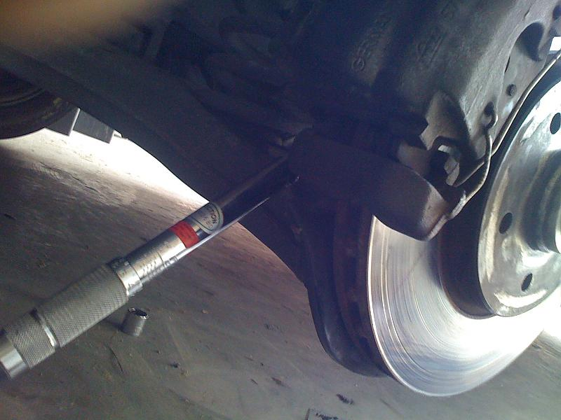 Front Wheel bearing replacement-caliper-bolts-remove.jpg
